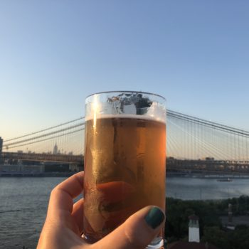 Beer glass with Brooklyn Bridge in the background